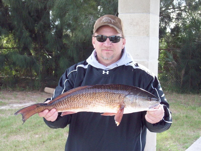 "Mark with a 27"" redfish."